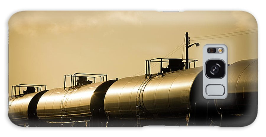 Natural Gas Galaxy Case featuring the photograph Gasoline Train At Sunset by Halbergman