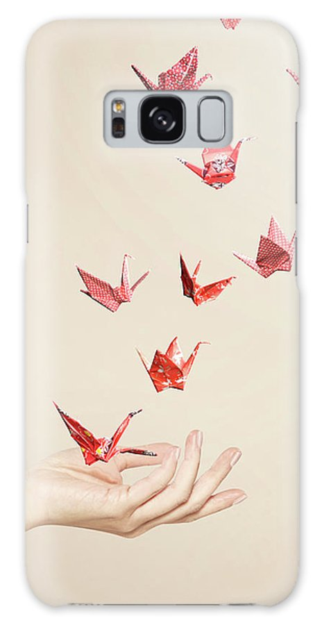 People Galaxy Case featuring the photograph Group Of Red Origami Cranes Flying Away by Paper Boat Creative