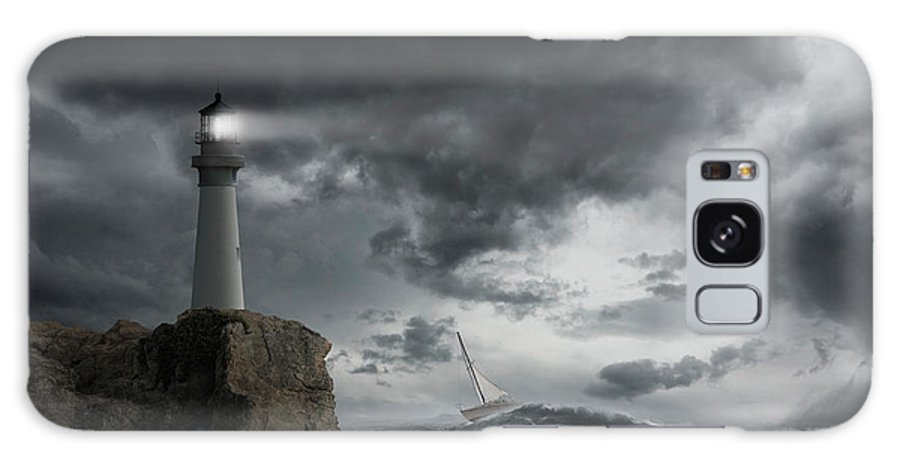 Risk Galaxy Case featuring the photograph Lighthouse Shining Over Stormy Ocean by John M Lund Photography Inc