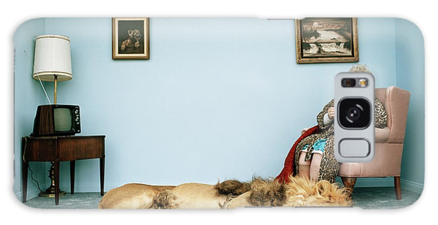 Pets Galaxy Case featuring the photograph Lion Lying On Rug, Mature Woman Knitting by Matthias Clamer