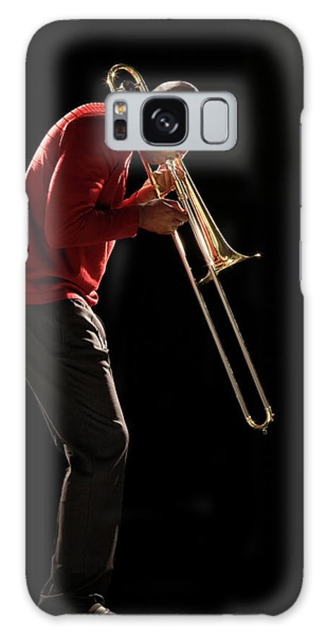 People Galaxy Case featuring the photograph Man Playing Trombone, Side View by Moodboard