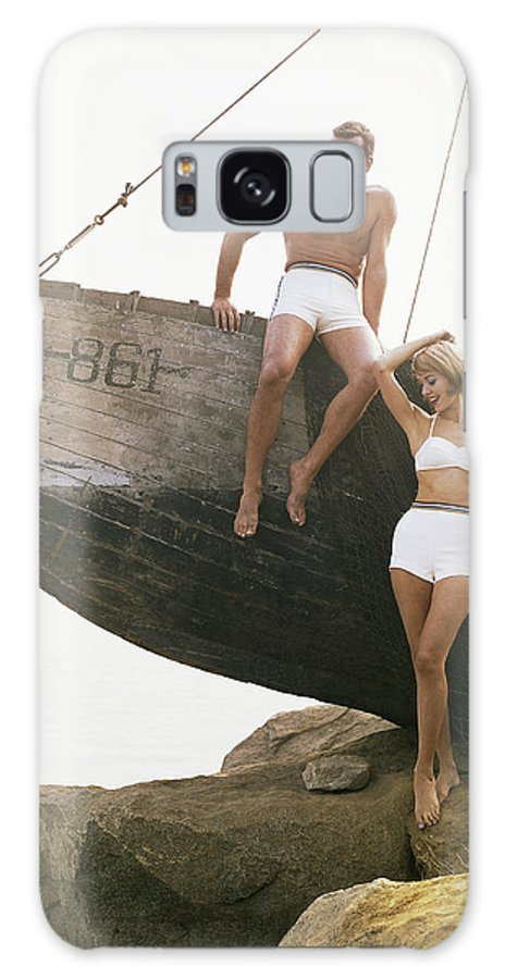 Hand Raised Galaxy Case featuring the photograph Man Sitting Boat, Woman Standing Beside by Tom Kelley Archive