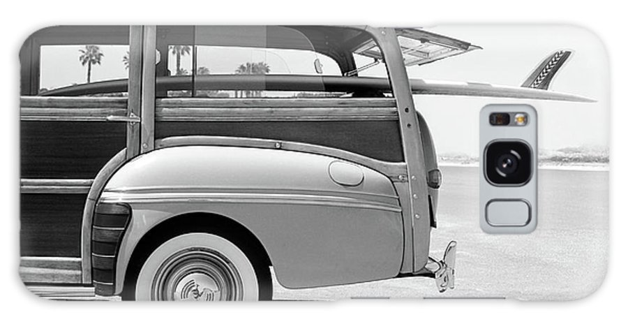1950-1959 Galaxy Case featuring the photograph Old Woodie Station Wagon With Surfboard by Skodonnell