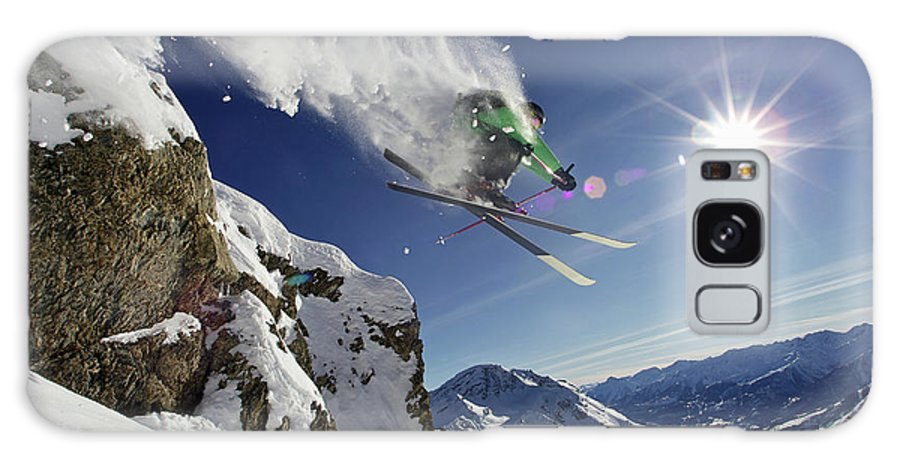 Young Men Galaxy Case featuring the photograph Skier In Midair On Snowy Mountain by Michael Truelove