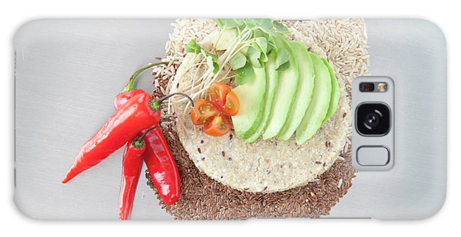 Flax Seed Galaxy Case featuring the photograph Sliced Avocado And Peppers With Grains by Laurie Castelli