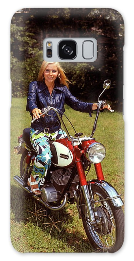 Engine Galaxy Case featuring the photograph Smiling Blonde Woman Sitting On Red by H. Armstrong Roberts