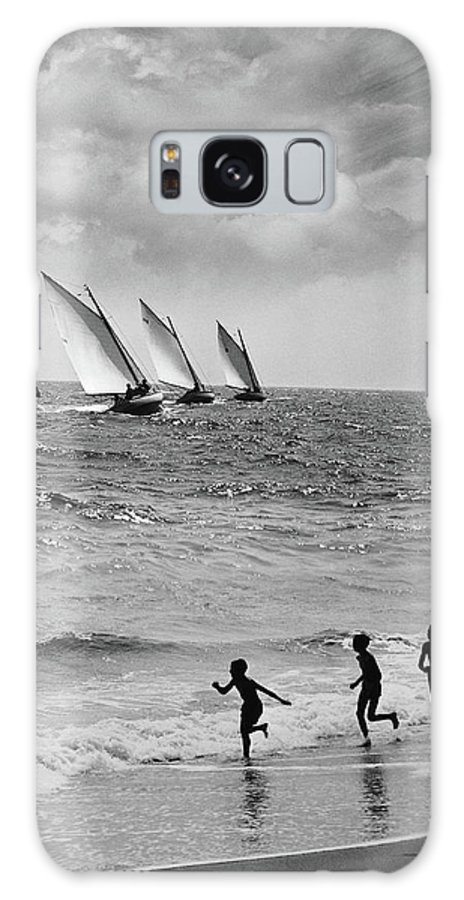 Following Galaxy Case featuring the photograph Three Boys Running Along Beach by Stockbyte