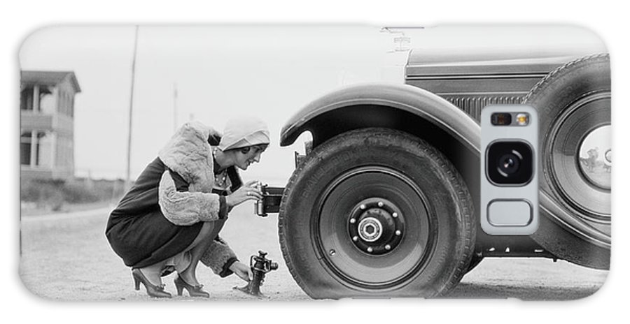 People Galaxy Case featuring the photograph Woman Changing Flat Tire On Car by H. Armstrong Roberts