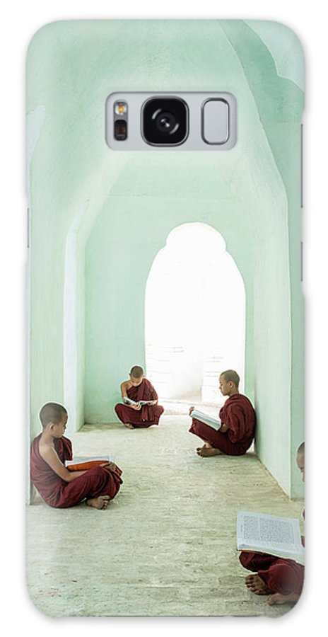 Arch Galaxy Case featuring the photograph Young Buddhist Monks Reading In Temple by Martin Puddy