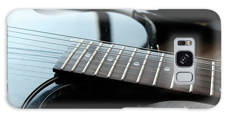 Guitar Galaxy Case featuring the photograph Guitar Fingerboard Or Fretboard Closeup by Luca Lorenzelli