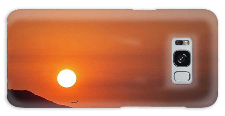 Sunset Galaxy Case featuring the photograph Red sunset and plane in flight by Hannes Roeckel