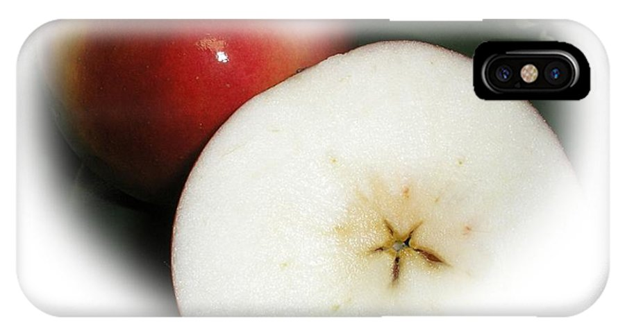 Red Apple IPhone X Case featuring the photograph Star In The Apple by Valerie Bruno