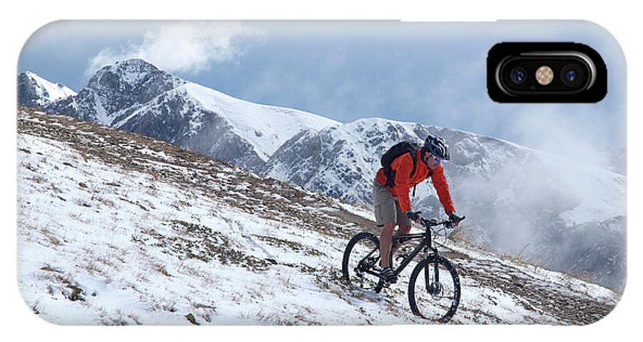 35-39 Years IPhone X Case featuring the photograph A Mountain Biker Rides Through The Snow by Menno Boermans