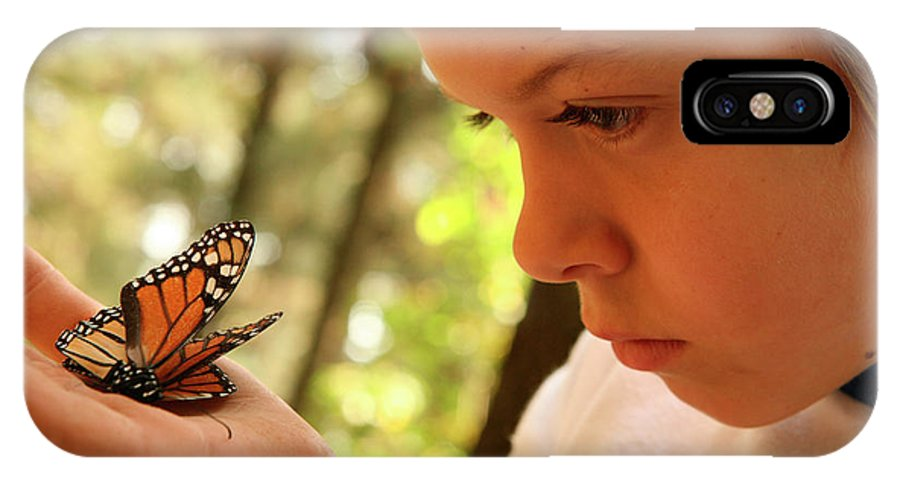 Angangueo IPhone X Case featuring the photograph A Young Boy Holds A Stick by Robb Kendrick