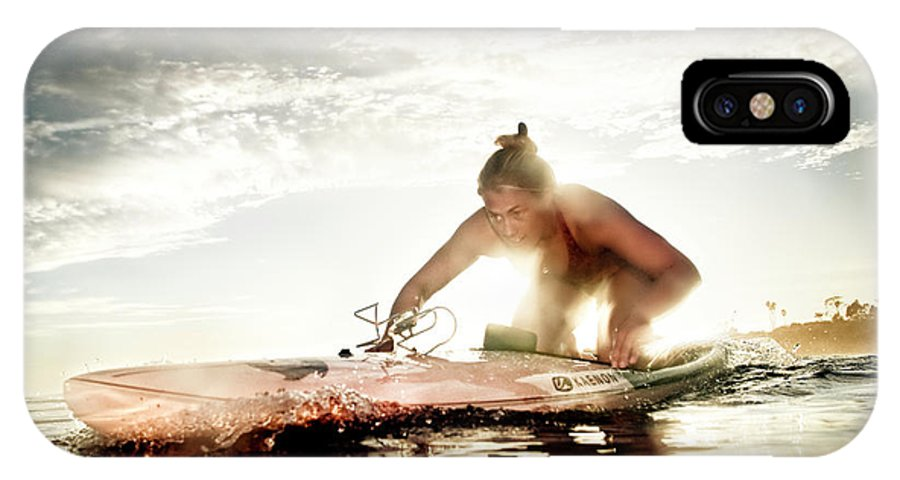 30-34 Years IPhone X Case featuring the photograph A Young Woman Paddling Hard by Kevin Steele