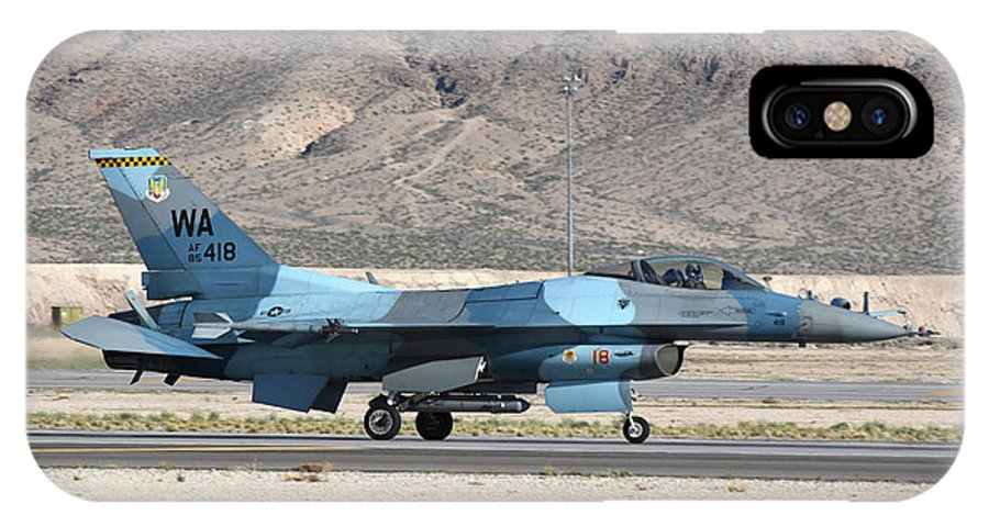 Nellis Air Force Base IPhone X Case featuring the photograph An F-16c Aggressor Jet Landing by Riccardo Niccoli