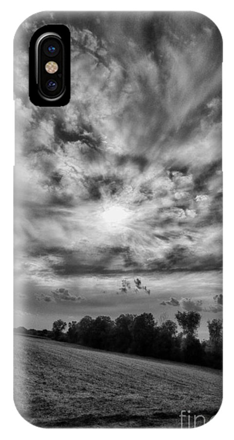 Dark Cloudy Skies IPhone X Case featuring the photograph Into The Sun by Brothers Beerens