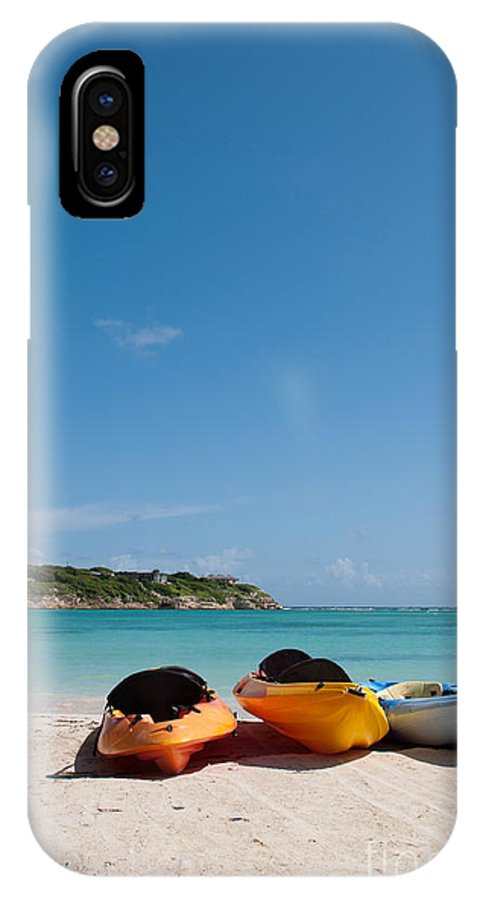 Beach IPhone X Case featuring the photograph Kayaks On Beach by Luis Alvarenga