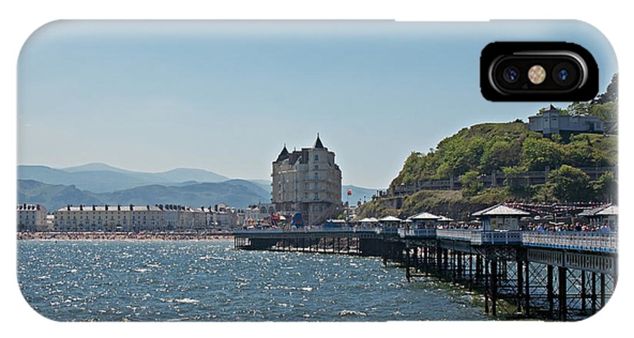 Pier IPhone X Case featuring the photograph Llandudno Pier In Wales Uk On A Bright Sunny Day by Ken Biggs