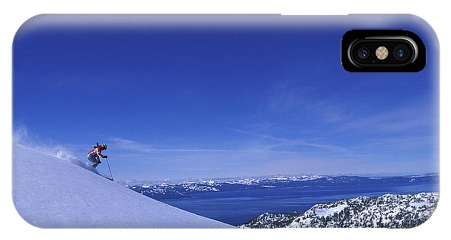 Action IPhone X Case featuring the photograph One Woman Skiing In Powder High by Corey Rich