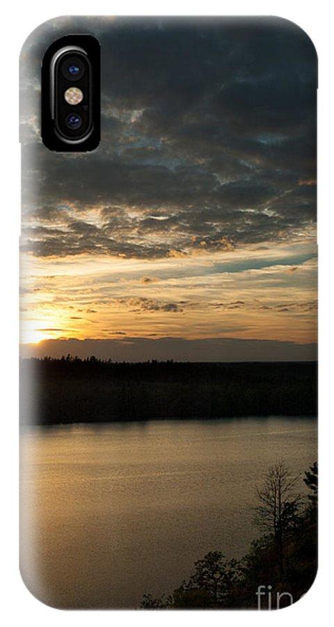 Aboda Klint IPhone X Case featuring the photograph sunset over Aboda Klint lake by Peter Noyce