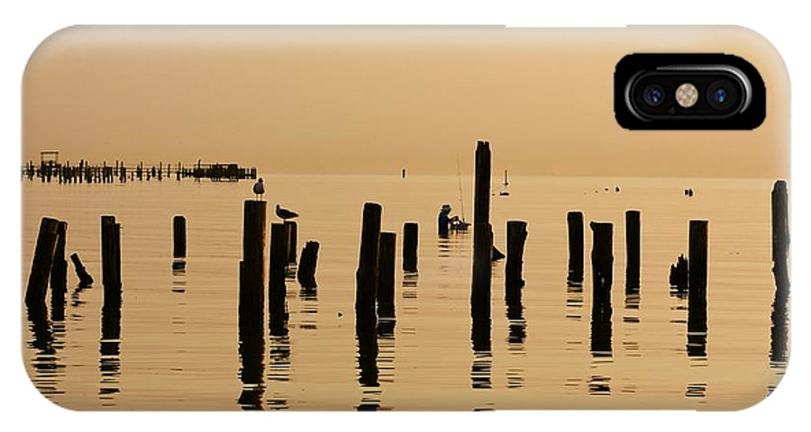Sunrise IPhone X Case featuring the photograph The Fisherman by Lisa Comperry