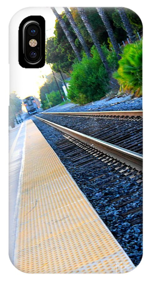 Train IPhone X Case featuring the photograph Ventura Train Station by Henrik Lehnerer