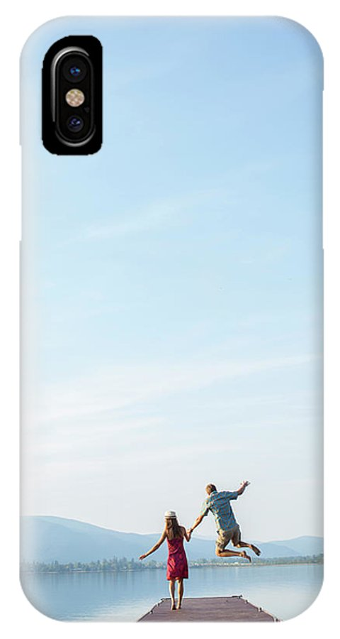 Copy Space IPhone X Case featuring the photograph Young Couple Running And Playing by Wood Wheatcroft