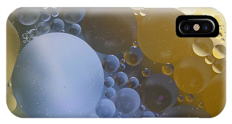Oil IPhone X Case featuring the photograph Abstraction Oil Bubbles In Water by Odon Czintos