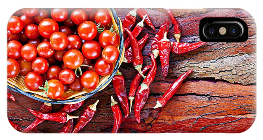 Tomato IPhone X Case featuring the photograph Basket Of Ripe Cherry Tomatoes And Dried Red Chillies On Rustic by Ken Biggs