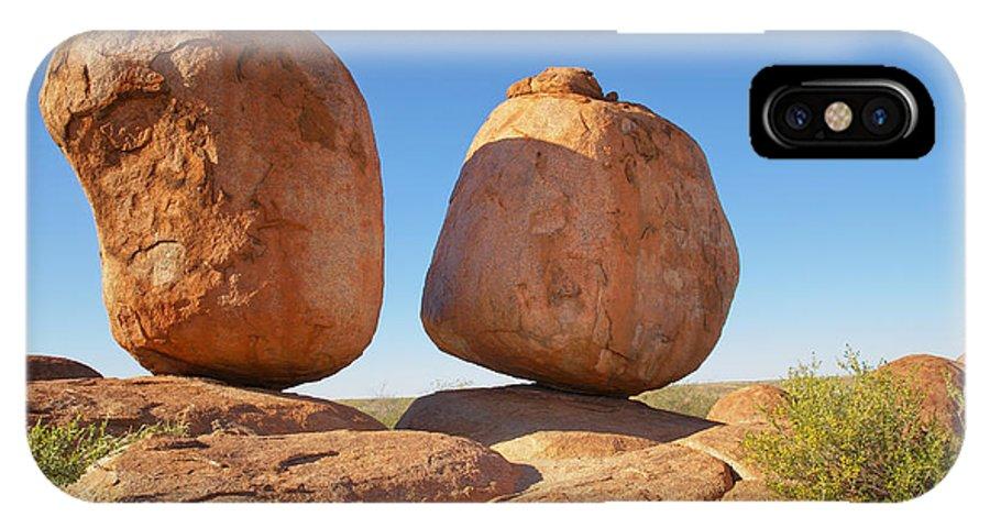 Australia IPhone X Case featuring the digital art Devils Marbles Karlu Karlu by Carol Ailles