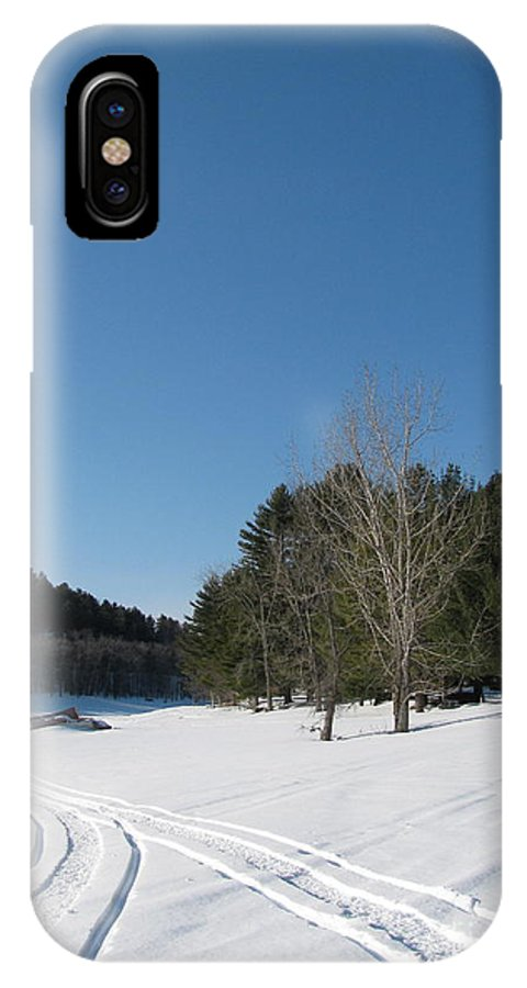 Snow IPhone X Case featuring the photograph Snowmobile Tracks by Nancie Johnson