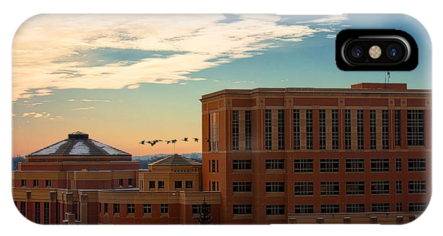Rochester Minnesota Geese Goose Bird Fowl Water Waterfowl Winter Snow Orange Red Yellow Blue White Sky Winter Scenic City Architecture Fly Flight Cloud Sun Sunrise Photographs IPhone X Case featuring the photograph Sunrise Flyby by Tom Gort