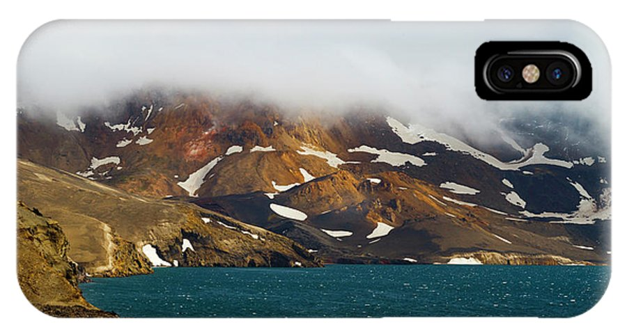 Arctic IPhone X Case featuring the photograph Iceland, Ice & Fire by Mikel Bilbao