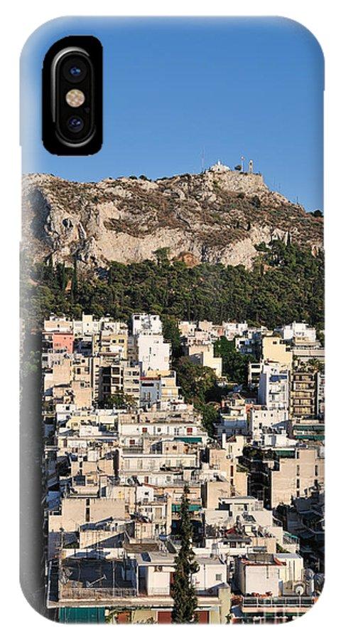 Athens; City; Capital; Attica; Attika; Attiki; Greece; Hellas; Greek; Hellenic; Europe; European; Afternoon; Light; Sunset; Sundown; Holidays; Vacation; Travel; Trip; Voyage; Journey; Tourism; Touristic; Summer; Summertime; Lykavittos; Lykavitos; Lycabettus; Hill; Strefi; View; Houses; Photos; Photograph; Photography IPhone X Case featuring the photograph Lycabettus Hill During Sunset by George Atsametakis