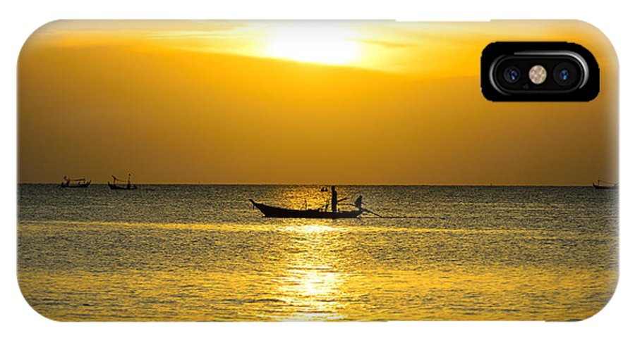 Asia IPhone X Case featuring the photograph Silhouette Fisherman Are Taking Fishing Boat by Chanchai Suttiprapa