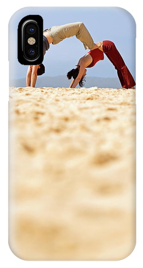 Australia IPhone X Case featuring the photograph A Man And Woman Practicing Yoga by Lars Schneider