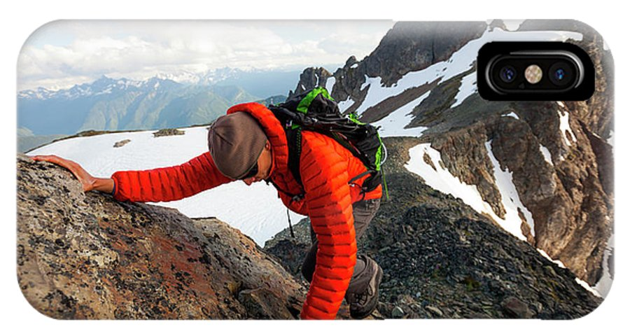 One Person IPhone X Case featuring the photograph A Climber Scrambles Up A Rocky Mountain by Christopher Kimmel