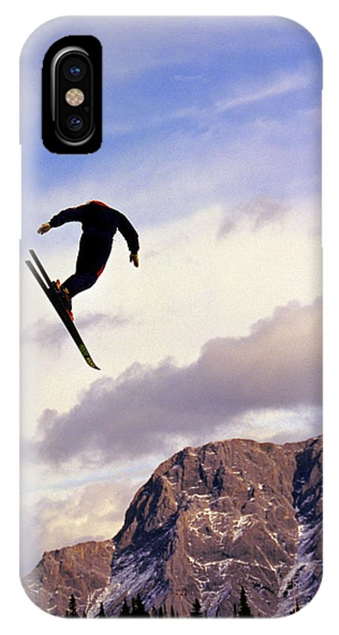 Aspiration IPhone X Case featuring the photograph A Freestyle Skier Takes A Jump In Utah by Robb Kendrick