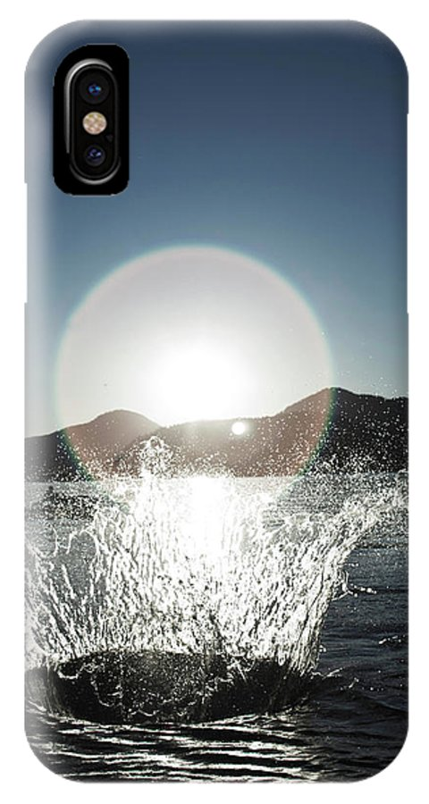 Action IPhone X Case featuring the photograph A Happy Young Women Canon Balls by Patrick Orton