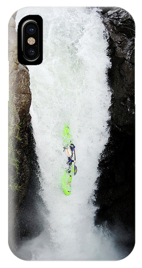 Action IPhone X Case featuring the photograph A Kayaker Takes The Plunge On Huge by Lucas Gilman