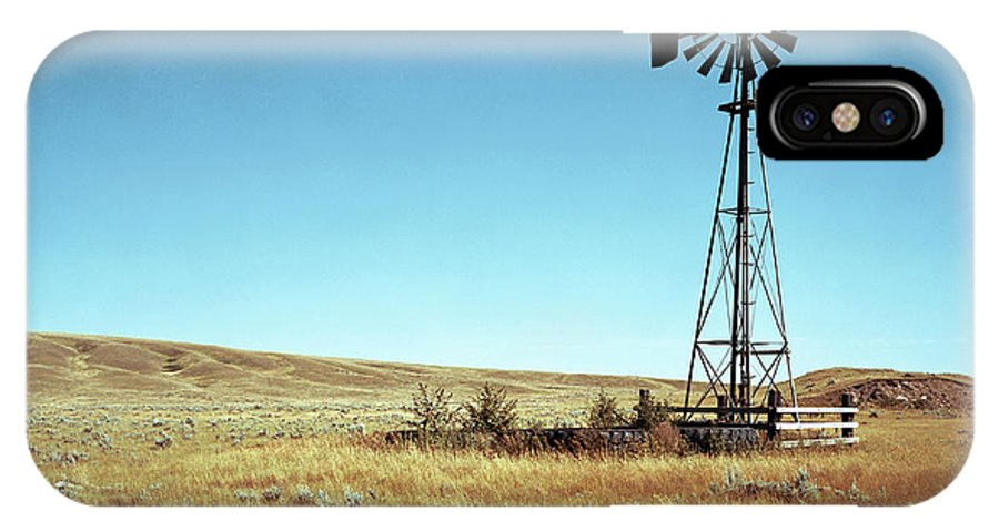 Agriculture IPhone X Case featuring the photograph A Lone Windmill Stands On The Canadian by Todd Korol