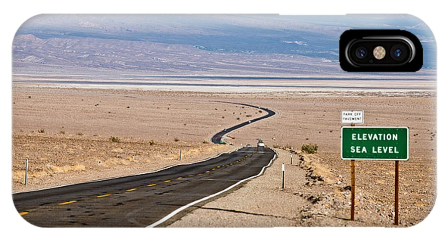 Arid IPhone X Case featuring the photograph A Long Road Through Death Valley by Rob Hammer