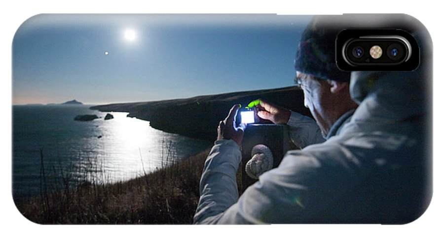 50-54 Years IPhone X Case featuring the photograph A Man Captures The Full Moon by Kevin Steele
