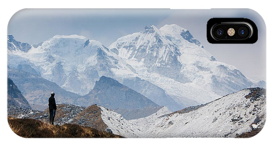 Himalayas IPhone X / XS Case featuring the photograph A Man Contemplates The Size Of Kanchenjunga by Helix Games Photography
