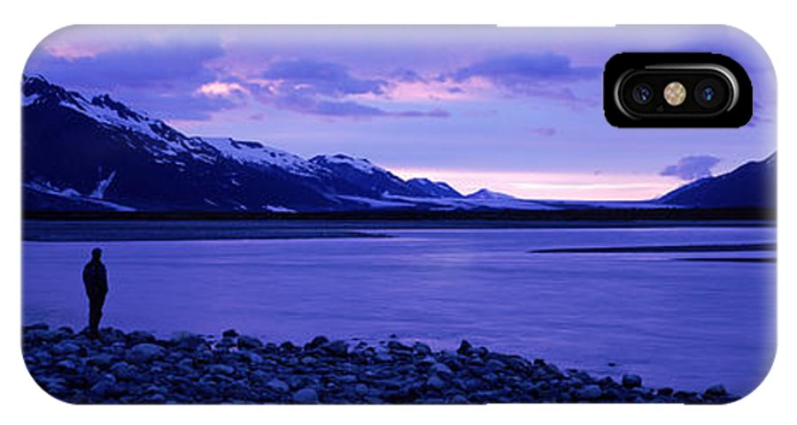 Alsek IPhone X Case featuring the photograph A Man Standing On The Edge Of A Lake by David McLain