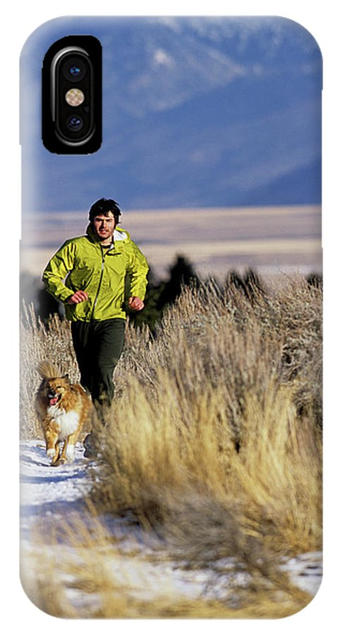 20s IPhone X Case featuring the photograph A Man Trail Runs On A Winter Day by Bob Allen