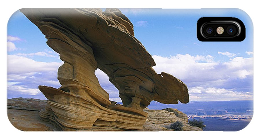 Rock Formations IPhone X / XS Case featuring the photograph A Rock Formation Shaped By Wind Erosion by Melissa Farlow