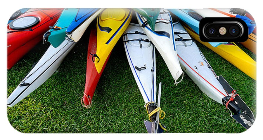 A Lot IPhone X Case featuring the photograph A Stack Of Kayaks by Amy Cicconi