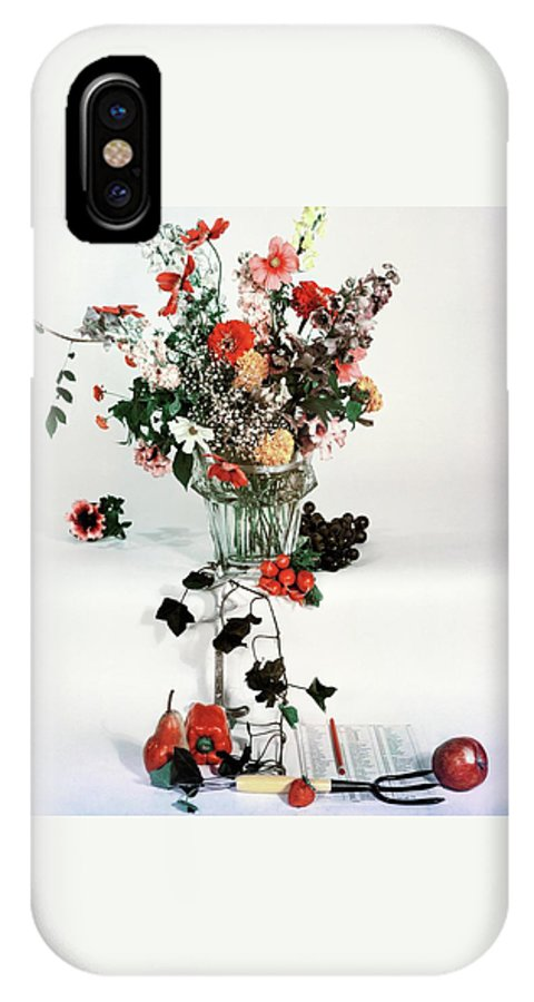 Nobody IPhone X Case featuring the photograph A Studio Shot Of A Vase Of Flowers And A Garden by Herbert Matter